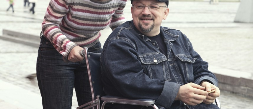 disability support services for man in an invalid carriage