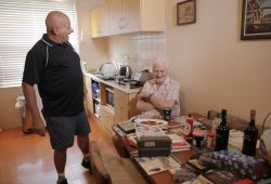 Client and support worker in the kitchen talking